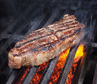 Image of meat on a grill.