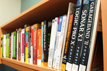 Photo of the shelf of reference books in the DMC.