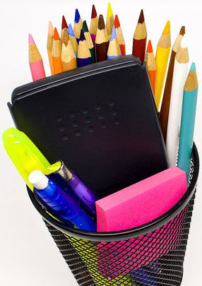 Image of school supplies including pencils, erasers and a calculator.