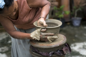 Picture of a woman making pottery