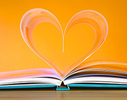 Image of book pages in the shape of a heart.
