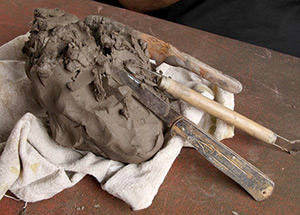 Photo of clay and tools for sculpting.