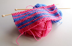 Image of knitting needles and yarn.