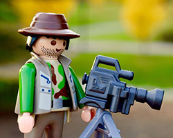 Image of a lego man filming