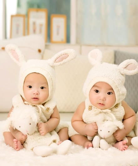 babies in rabbit hats