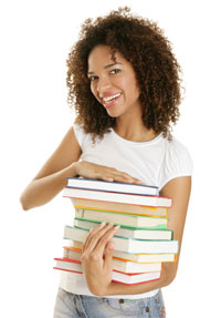 A woman with a stack of books.