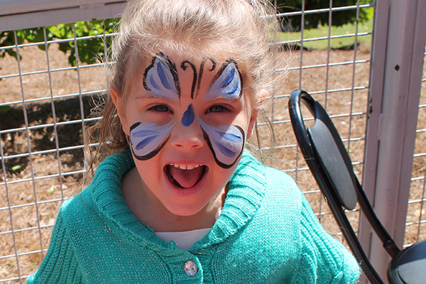 Photo of a child with her face painted.