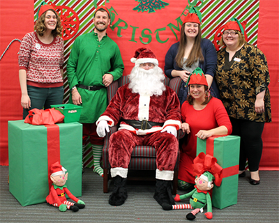 Photo of the Children's Department staff with Santa Claus.