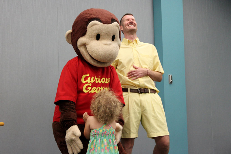 Photo of Curious George and the man in the yellow hat