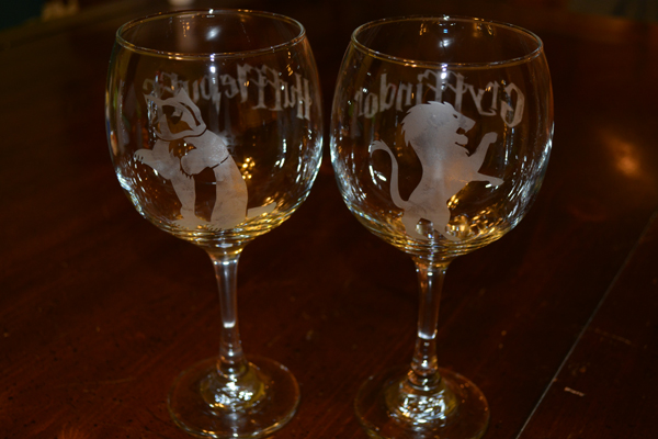 Photo of two glasses etched with custom designs.