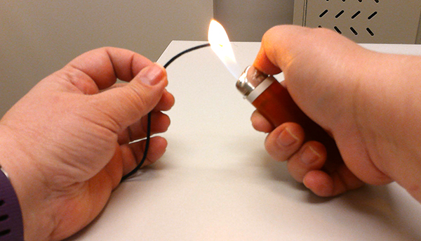 Photo of the cord ends being passed through a flame.
