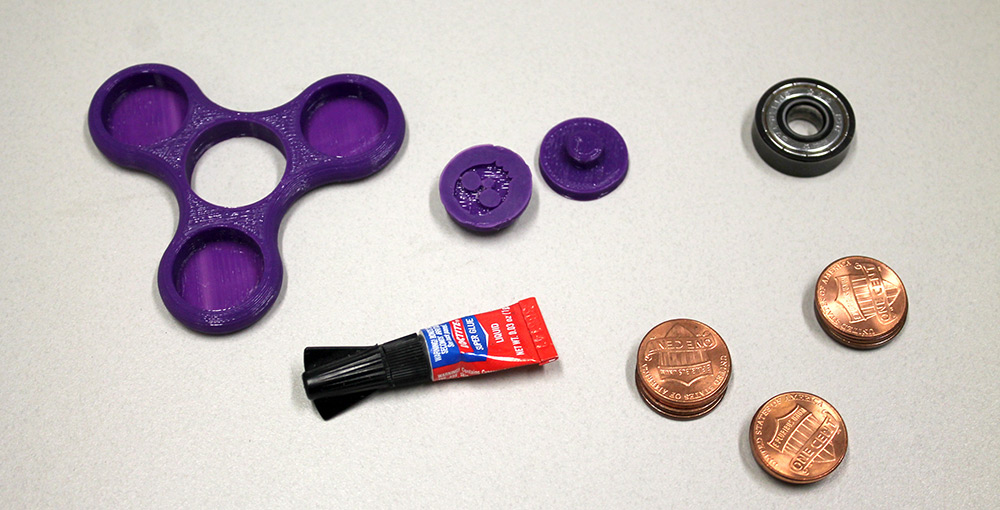 Photo of all of the parts needed to make a spinner.