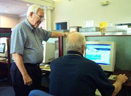 A photo of two men using the Heritage Room computer resources.