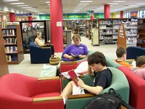 A photo of teens reading at the library.